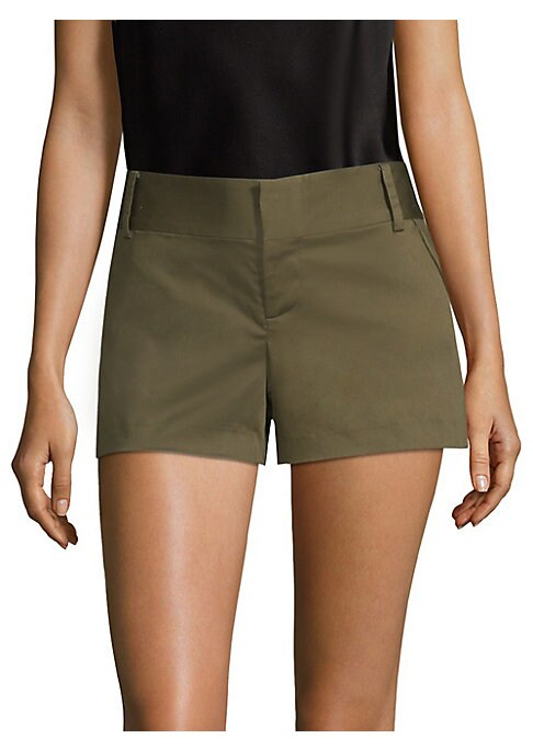 """Image of Cotton shorts in subtle sheen finish. Belt loops. Front zip-fly with concealed closure. Front slash pockets. Back welt pockets. Rise, about 8"""".Inseam, about 4"""".Cotton/elastane. Dry clean. Imported. Model shown is 5'10"""" (177cm) wearing US size 4. ."""