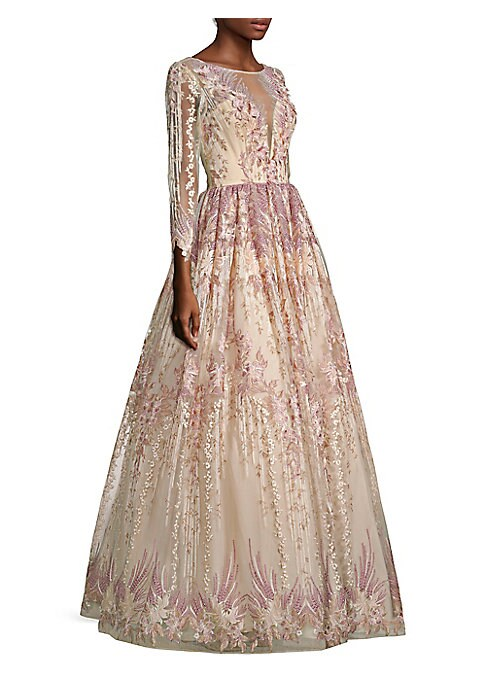"""Image of A sweeping modern ball gown with delicate floral embroidery. Illusion neckline. Three-quarter sleeves. Concealed back zip closure.V back. About 62"""" shoulder to hem. Polyester. Lined. Dry clean. Imported. Model shown is 5'10"""" (177cm) wearing US size 4."""
