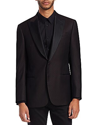 Image of From the Saks IT LIST THE JACKET The wear everywhere layer that instantly dresses you up. Sophisticated wool dinner jacket with silk lapels and subtle diamond-weave pattern Peak lapels with buttonhole Long sleeves Button cuffs Button front closure Chest w