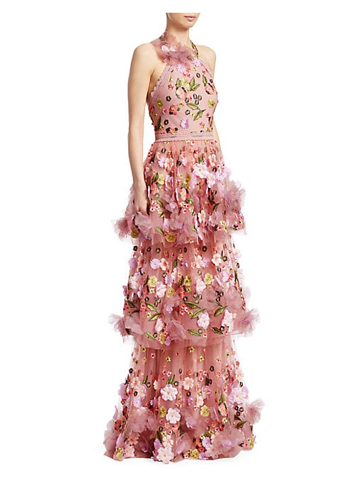 "Image of Eye-catching gown with tiered ruffle skirt and floral design. Halterneck. Sleeveless. Concealed back zip. Lined. About 60"" from shoulder to hem. Nylon. Dry clean. Imported. Model shown is 5'10"" (177cm) and wearing US size 4."