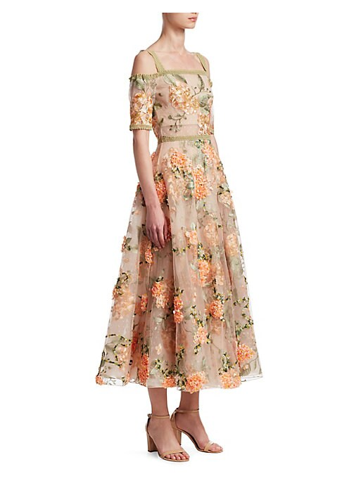 """Image of Shoulder-baring dress with allover floral design. Off-the-shoulder neckline. Short sleeves. Concealed back zip. Lined. About 48"""" from shoulder to hem. Nylon/polyester. Dry clean. Imported. Model shown is 5'10"""" (177cm) and wearing US size 4."""