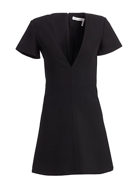 Image of A plunging v-neckline sets this LBD apart from the rest. It's cut from luxurious wool and falls to a mini-length silhouette. Pair yours with dramatic, thigh-high boots.V-neck. Short sleeves. Wool. Silk lining. Concealed back zip closure. Dry clean. Import