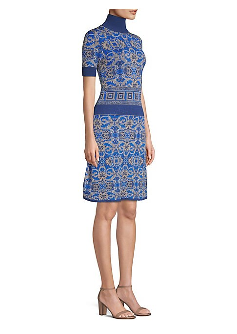 Image of Versace's turtleneck dress is done up in bold blues in the house's intricate prints. This knit piece is cut for a close fit to the body and finished with a flattering, fit-and-flare skirt. Turtleneck. Short sleeves. Pullover style. Viscose/polyamide/polye