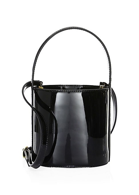 Image of .Minimalistic bucket bag made from high shine patent leather. Open top. Goldtone hardware. Lined. Leather. Imported.
