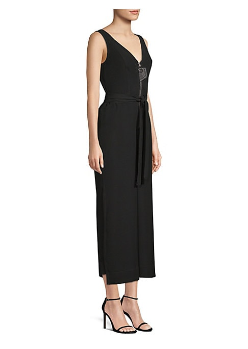 Image of This chic, inky black jumpsuit features a zippered bodice with a wide-leg pant that's executed in an on-trend cropped length. Asymmetrical hems and a leather flap detail help elevate the piece to high fashion.V-neck. Sleeveless. Front zip and self-tie clo