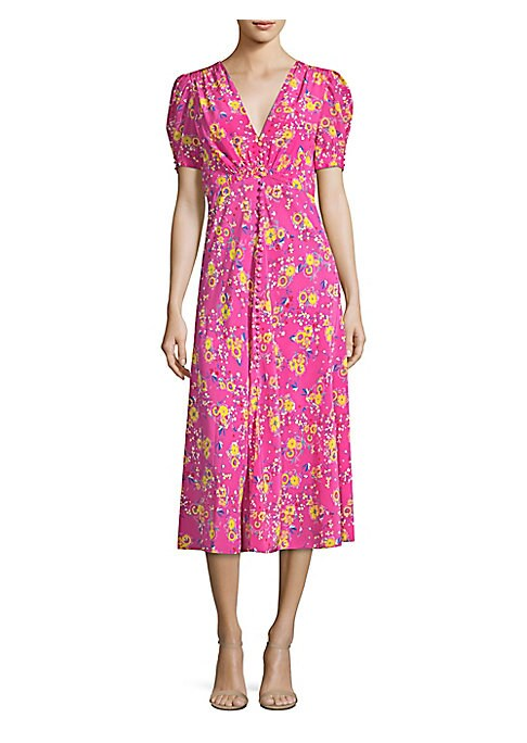 """Image of From the Saks It List: Garden Party Florals. Silk button-front dress in colorful floral print.V-neck. Short sleeves. Button-front. Concealed back zip closure. About 50"""" from shoulder to hem. Silk. Dry clean. Imported. Model shown is 5'10"""" (177cm) wearing"""