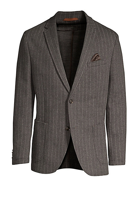 """Image of Elegant pinstripes elevate striking sport jacket. Notch lapels. Long sleeves. Buttoned cuffs. Button front. Chest welt pocket. Waist patch pockets. About 31"""" from shoulder to hem. Cotton/wool/polyester. Dry clean. Imported."""