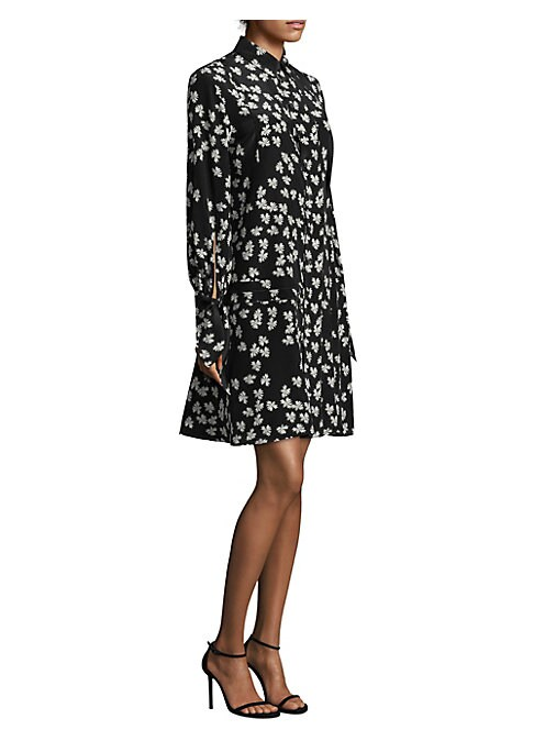 """Image of A flowy and feminine shirtdress in air-soft silk. This printed dress is detailed with tie-sleeves and pleats for a subtle twist on a classic silhouette. Point collar. Long sleeves. Button front. Silk. Dry clean. Imported. SIZE & FIT. About 39.5"""" from shou"""