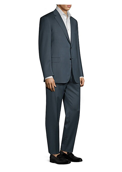 """Image of Classic suit tailored from luxe wool fabric. Lined. Wool. Dry clean. Made in Italy. JACKET. Notch lapels. Long sleeves. Buttoned cuffs. Button front. Chest welt pocket. Waist flap pockets. About 30"""" from shoulder to hem. PANTS. Inseam, about 36"""".Leg openi"""