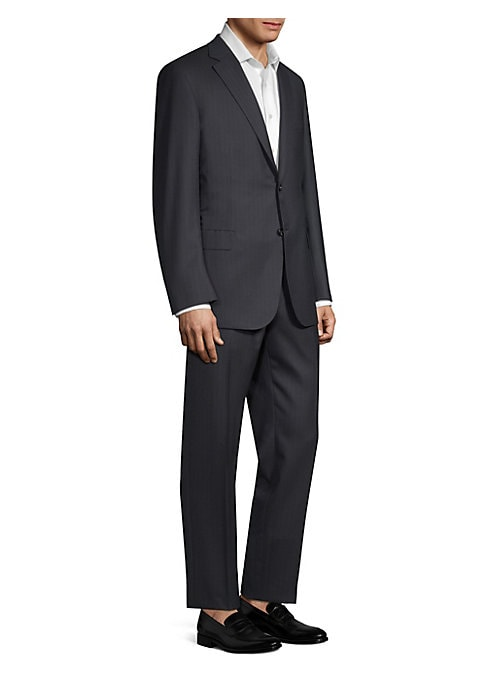 """Image of Classic suit tailored from luxe wool fabric. Lined. Regular-fit. Wool. Dry clean. Made in Italy. JACKET. Notch lapels. Long sleeves. Buttoned cuffs. Button front. Chest welt pocket. Waist flap pockets. About 30"""" from shoulder to hem. PANTS. Rise, about 10"""