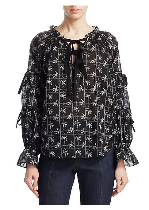 """Image of Airy cotton blouse in artful floral print.V-neck. Long sleeves. Lace-up front. Pullover style. About 26"""" from shoulder to hem. Cotton. Dry clean. Imported. Model shown is 5'10"""" (177cm) wearing US size Small."""