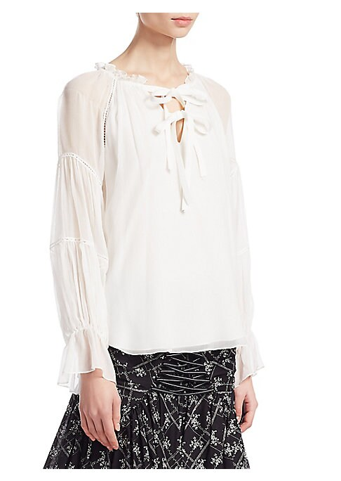 """Image of Semi-sheer silk blouse with lace-up front.V-neck. Long sleeves. Lace-up front. Pullover style. About 25"""" from shoulder to hem. Silk. Dry clean. Imported. Model shown is 5'10"""" (177cm) wearing US size Small."""