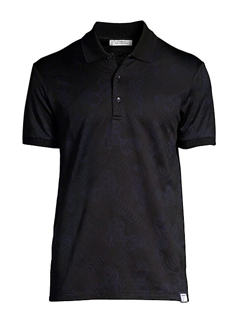 "Image of Polo shirt patterned by subtle tonal rococo print. Polo collar. Three-button placket. Short sleeves. Pullover style. About 28"" from shoulder to hem. Cotton. Machine wash. Imported."