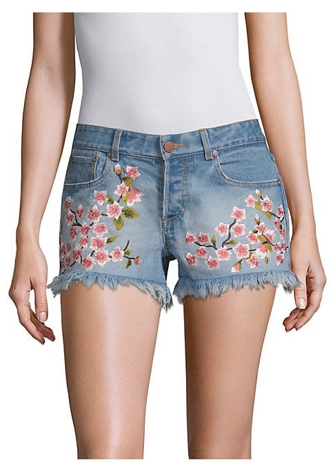 """Image of Frayed button-fly denim shorts with floral embroidery. Belt loops. Button fly with button closure. Five-pocket style. Cotton/elastane. Hand wash. Imported. SIZE & FIT. Rise, about 9"""".Inseam, about 3"""".Model shown is 5'10"""" (177cm) wearing US size 4."""