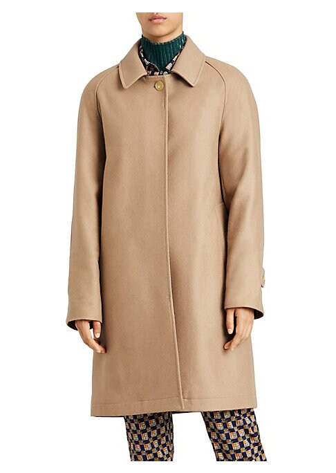 Image of Burberry is an iconic brand that is renowned for their timeless coats and minimalist design. Simple and elegant, this piece is reminiscent of this iconic British brand. Spread collar. Long sleeves. Tab-button cuffs. Button front. Waist slip pockets. Back