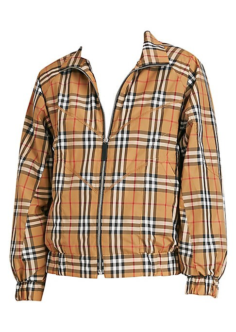 Image of From the Saks IT LIST. STATEMENT OUTERWEAR. From sleek and fitted to puffy and bright, there's a coat for every occasion. MAD FOR PLAID. See the traditional check in dozens of new ways. Iconic brand's tartan elevates tracksuit jacket to timeless style. Sp