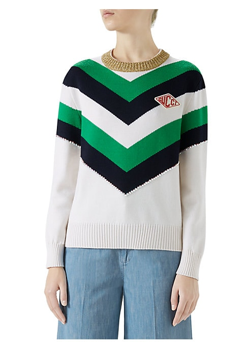 "Image of Wool intarsia knitted top. Crewneck. Long sleeves. Pullover style. Goldtone lurex collar. Jeweled trim. Gucci game patch. About 24"" from shoulder to hem. Wool/metal/nylon. Dry clean. Made in Italy. Model shown is 5'10"" (177cm) wearing a US size Small."