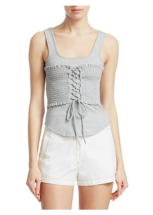 """Image of Alluring corseted bodice adds shape to easy tank. Scoop neck. Shoulder straps. Pullover style. Smocked bodice with lattice front. Scoop back. Shirttail hem. About 19"""" from shoulder to hem. Polyester/cotton. Dry clean. Made in USA. Model shown 5'10"""" (177cm"""