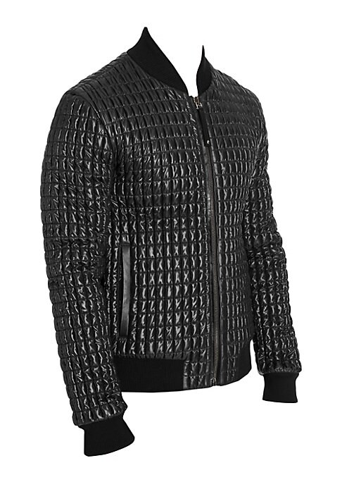 Image of Quilted jacket with leather trim offers striking puffer effects to jacket. Baseball collar. Long sleeves. Rib-knit at neck, cuffs and hem. Zip front. Waist slip pockets. Polyester lining. Nylon. Trim: leather. Dry clean. Made in Italy of imported fabric.