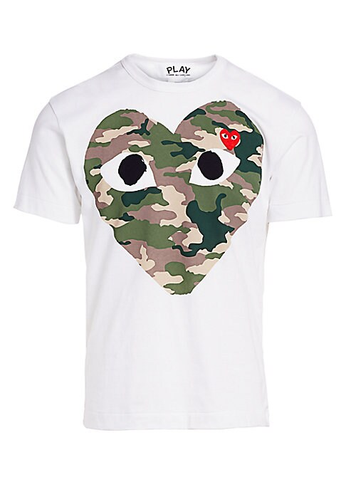 """Image of Camo print logo heart features peering eyes that adorn tee. Crewneck. Short sleeves. Pullover style. About 27"""" from shoulder to hem. Cotton. Machine wash. Imported."""