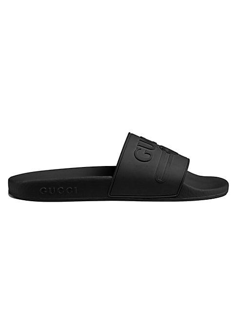 Image of Gucci logo rubber slide sandal. Rubber upper. Embossed Gucci vintage logo. Molded rubber footbed. Gucci logo embossed on the sole. Made in Italy.