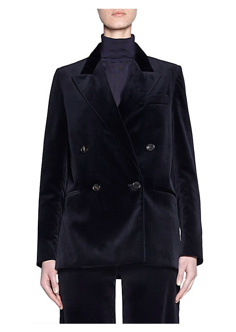 Image of As a modern take on the classic double-breasted blazer, this jacket is made from plush velvet and is cut to a perfectly oversized fit. Peak lapels. Long sleeves. Double-breasted button front. Chest welt pocket. Waist welt pockets. Lined sleeves. Cotton. D