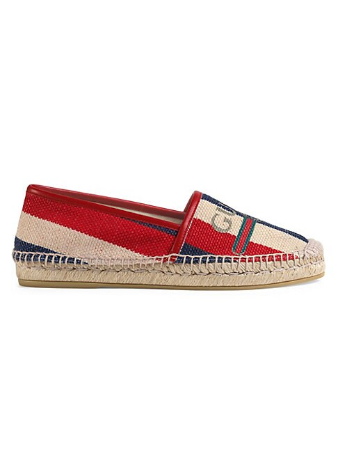 Image of Gucci logo Sylvie canvas espadrille. Cord platform. Hibiscus red leather trim. Gucci vintage logo. Sylvie baiadera linen canvas with a washed effect upper. Rubber sole. Made in Italy. Please note: Pattern may vary