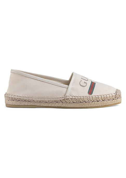 Image of Gucci logo canvas espadrille. Cord platform. Off-white leather trim. Off-white canvas with Gucci vintage logo upper. Rubber sole. Made in Italy.