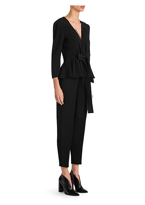 Image of A chic work-wear piece, this strech-cady jumpsuit is gathered at the flattering peplum waist with a feminine bow accent. Dainty puff sleeves and button loops imbue the look with a sartorial grace.V-neck. Three-quarter length puff sleeves. Button front clo