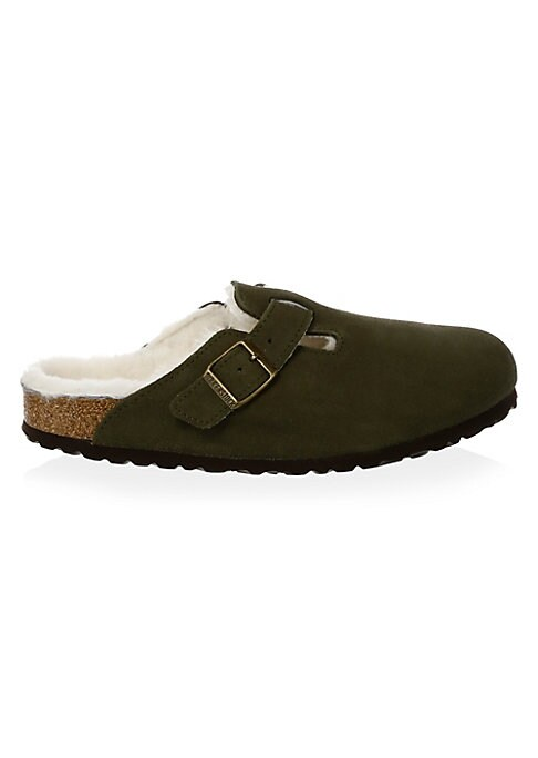 Image of Enduring clog-style slides with sheepskin lining. Suede upper. Buckled vamp. Round toe. Fur lining. Cork footbed. Narrow width. Rubber sole. Fur type: Dyed shearling. Fur origin: New Zealand. Imported.
