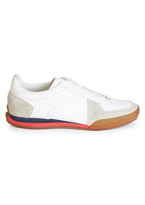 Image of From the Saks IT LIST. GOOD SPORT. Performance pieces in innovative fabrications go beyond the gym. Leather tennis sneakers with contrast sole. Leather upper. Round toe. Lace-up vamp. Rubber sole. Made in Italy.