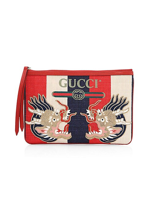 """Image of Gucci print pouch. Zipper closure. Goldtoned hardware. Gucci vintage logo print. Embroidered dragon appliques.11.5""""W X 8""""H.Sylvie baiadera linen canvas with a washed effect. Hibiscus red leather trim. Made in Italy."""