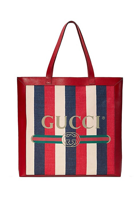 """Image of Gucci print medium tote. Double leather handles with 11"""" drop. Brass hardware. Interior zipper pocket. Gucci vintage logo print. Leather trim. Cotton linen lining.16.25""""W X 17""""H X 2.25""""D.Sylvie baiadera linen canvas with a washed effect. Made in Italy."""