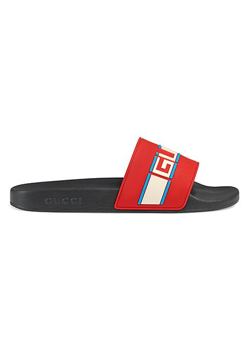 Image of Rubber slides with Gucci stripe. Molded rubber footbed. Gucci logo embossed on the sole. Rubber. Made in Italy.
