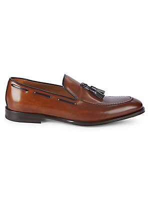 Image of Burnished leather loafer with classic tassel trim Leather upper, lining & sole Round toe Slip-on style Padded insole Made in Italy. Men's Shoes - Mens Classic Footwear > Saks Fifth Avenue. Bruno Magli. Color: Cognac. Size: 9.5.