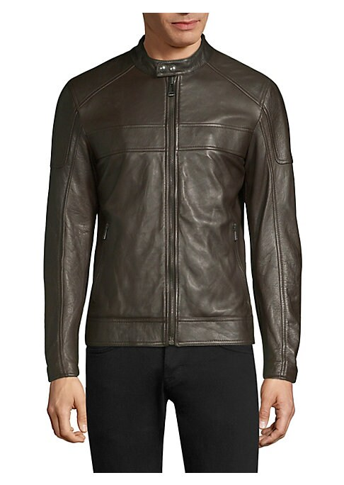 """Image of Classic leather jacket finished with patchwork design. Mockneck. Long sleeves. Zippered cuffs. Exposed front zip with snap closure. Waist zip pockets. Lined. About 26"""" from shoulder to hem. Leather. Dry clean by leather specialist. Made in Italy."""