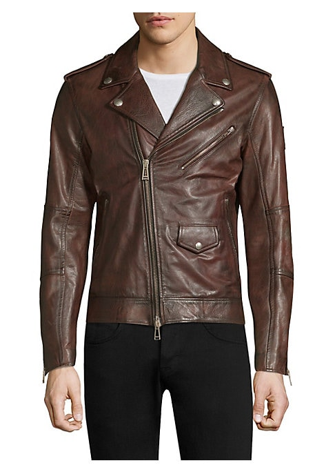 """Image of Classic leather jacket finished with patchwork design. Notch lapels. Epaulettes. Long sleeves. Zippered cuffs. Exposed front zip. Chest zip pocket. Waist snap-flap pocket. Waist zip pockets. Lined. About 26"""" from shoulder to hem. Leather. Dry clean by lea"""