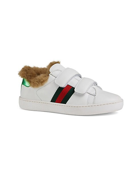 Image of Sporty sneaker with plush faux-fur lining features iconic side stripes and metallic red panel on the back of one shoe and metallic green on the back of the other shoe. Leather upper. Rubber sole. Fur type: faux. Made in Italy.