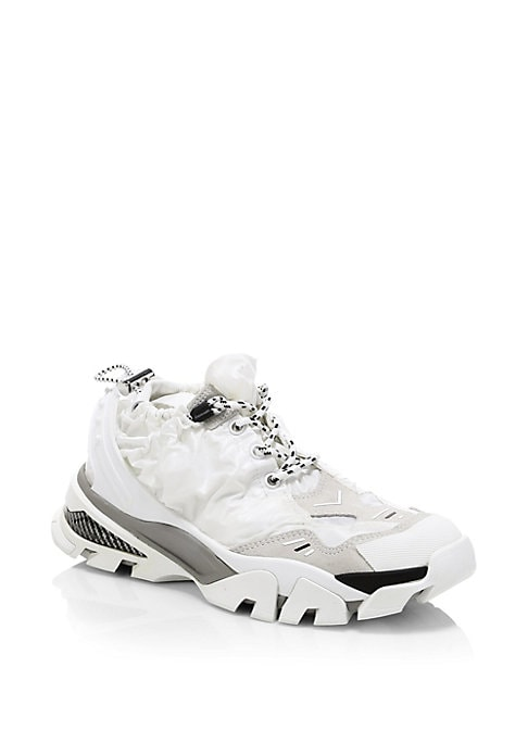 Image of Athletic sneakers with a modern drawstring design. Leather/textile upper. Lace-up vamp. Drawstring upper. Round toe. Leather lining. Rubber sole. Imported.