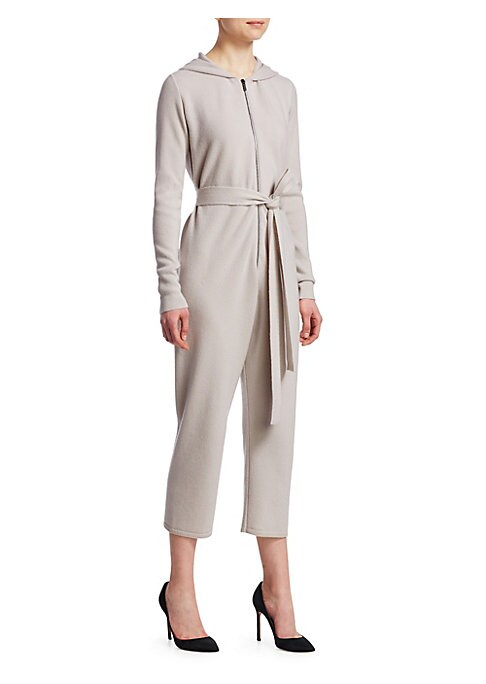 Image of With a cozy hood, easy zippered front and cropped leg, this knit jumpsuit is made for those who wish to blend style with comfort. Crafted out of pure cashmere, this is the height of lounge wear. Roundneck with attached hood. Long sleeves. Ribbed cuffs and