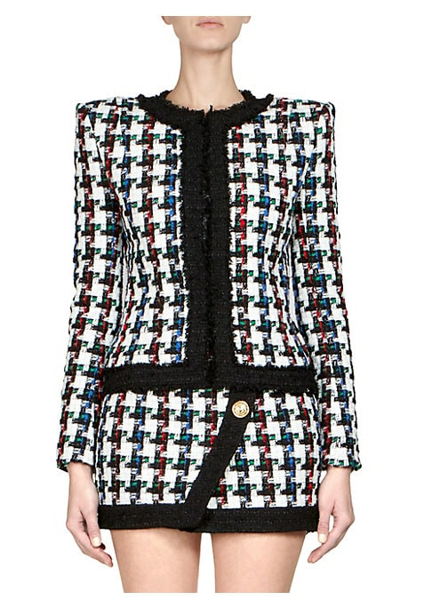 Image of From the Saks IT LIST. MAD FOR PLAID. See the traditional check in dozens of new ways. This colorful tweed jacket is classic in design and cropped in silhouette. Designed with a contrast trim, it accentuates the geometric visuals on this jacket. Roundneck