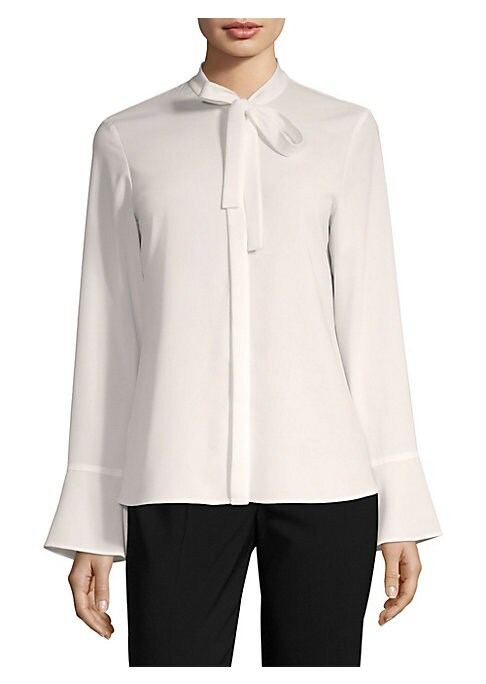 "Image of A modern work-wear staple, this blouse flaunts bell-sleeves and a chic neck tie. Tied mockneck. Long bell sleeves. Self-tie neck closure. About 25"" from shoulder to hem. Polyester/elastane. Hand wash. Imported. Model shown is 5'10"" (177cm) wearing a US si"