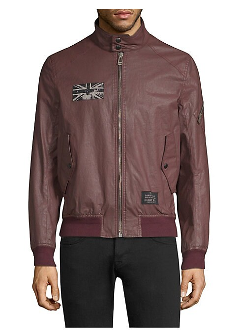 """Image of Washed Union Jack patch at the chest elevates edgy crinkled bomber jacket. Snap-button stand collar. Long sleeves with zip pocket. Rib-knit cuffs and hem. Zip front. Waist snap-button flap pockets. Viscose lining. About 26"""" from shoulder to hem. Cotton. D"""