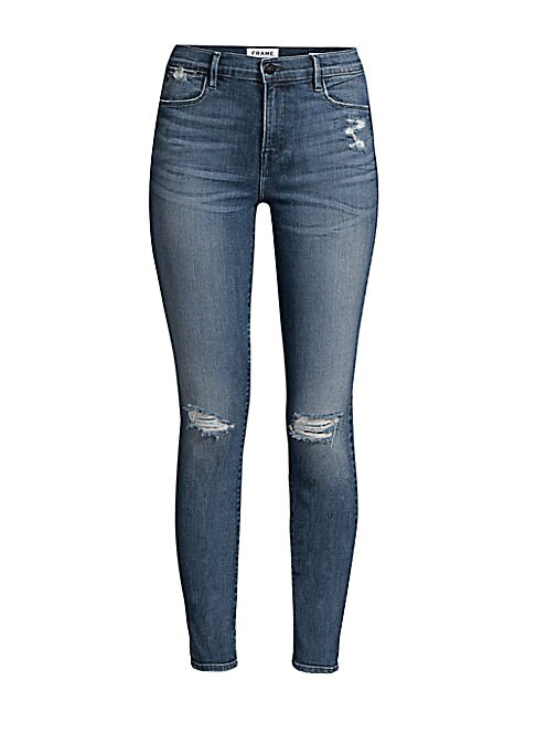 "Image of Cropped skinny jeans with distressed details and ripped knees. Belt loops. Zip fly with button closure. Five-pocket style. Cotton/polyester/elastane. Machine wash. Made in USA. SIZE & FIT. Rise, about 10"".Inseam, about 28"".Leg opening, about 10.25"".Model"