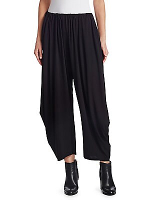 Image of Reminiscent of a '90s pant, these tapered trousers are finished with streamlined draping for the right mix of casual and chic. Cut to hit mid-calf, pair them with leather booties for a moto edge. Gathered elasticized waistband Slip-on style Side seam pock