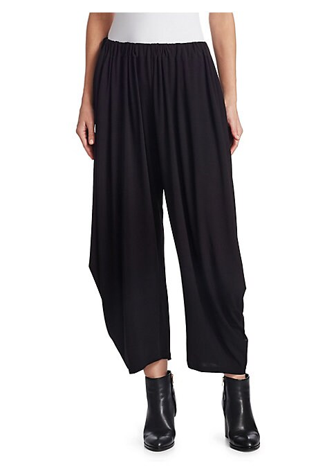 Image of Reminiscent of a '90s pant, these tapered trousers are finished with streamlined draping for the right mix of casual and chic. Cut to hit mid-calf, pair them with leather booties for a moto edge. Gathered elasticized waistband. Slip-on style. Side seam po