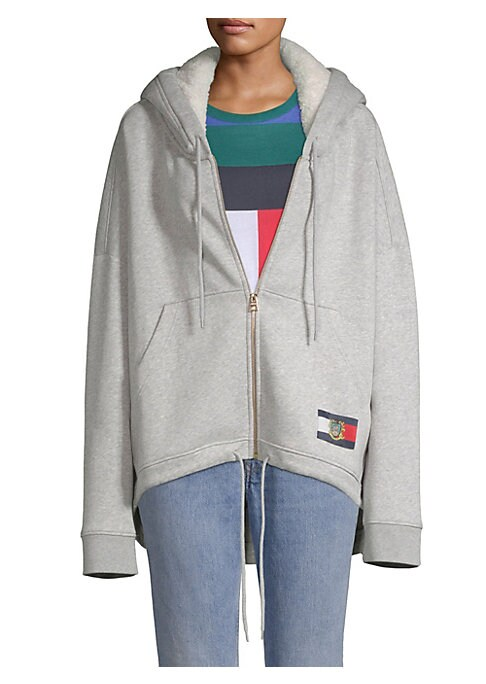 """Image of Cotton fleece hi-lo hoodie finished with a multi-color embroidered logo back design. Attached fleece-lined drawstring hood. Long sleeves. Front zip close. Side hand pockets. Hi-lo drawstring hem. Banded cuffs. About 31"""" from shoulder to hem. Cotton. Dry c"""