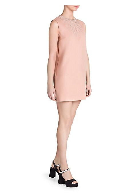 Image of This minimalist shift dress is cut to a leg-baring mini length for a 60's mod-inspired feel and flaunts a delicate jeweled neckline. Forgo accessories and let the embellishments catch the light, instead pairing with a bold statement heel. Roundneck. Sleev