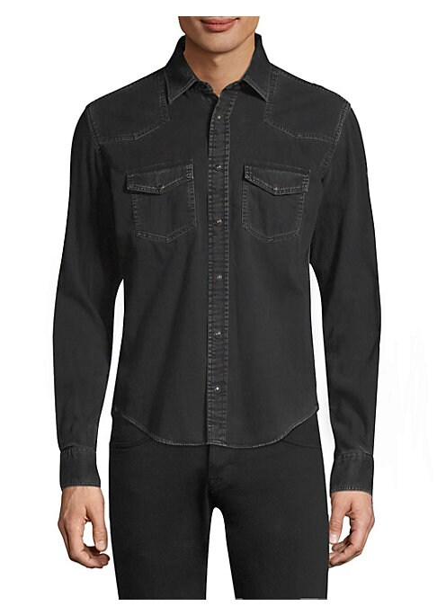 """Image of Cotton denim shirt in button-front style. Fold-over collar. Long sleeves. Front flap-snap patch pockets. Snap button-front. About 27"""" from shoulder to hem. Cotton. Dry clean. Imported. ."""