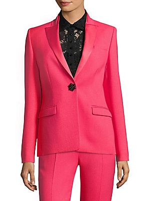 Image of Crafted in hot pink and flaunting a luxe jewel button accent, this tailored tuxedo jacket is the ultimate statement piece. Satin lapels and a rich knit finish add texture and a feminine touch to this menswear-inspired jacket. Satin winged lapels Long slee